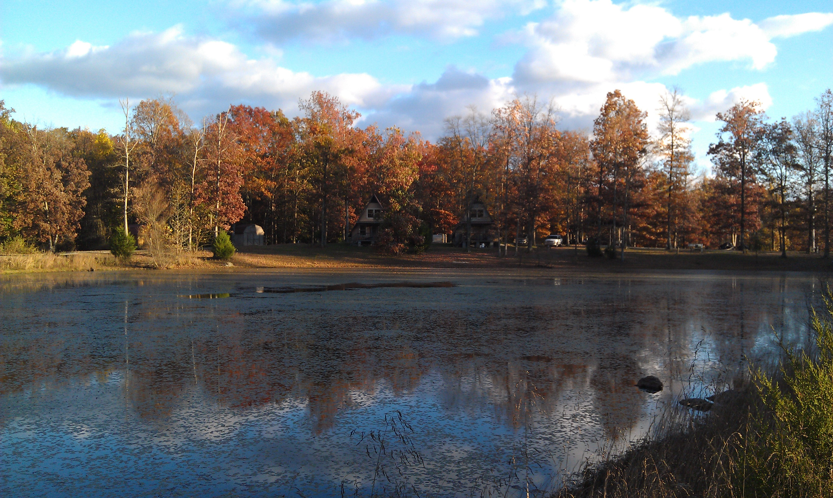 Campground in Autumn from across pond